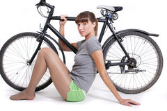 Woman with bike Stock Photography