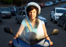 Woman on the bike Stock Images
