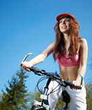 Woman with bike Royalty Free Stock Photo