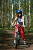 Woman and bike. Young woman and bike in the forest Stock Photo