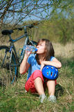 Woman and bike. Young woman and bike - break Stock Images