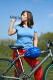 Woman and bike. Young woman and bike - break Royalty Free Stock Images