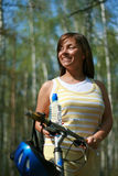 Woman and bike. Young woman and bike in the forest - break Stock Photography