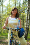 Woman and bike. Young woman and bike in the forest - break Royalty Free Stock Photography