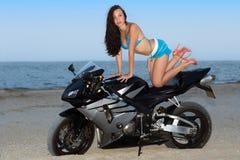 Woman on the bike Stock Image