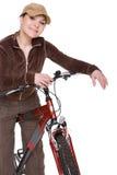 Woman on bike Stock Image