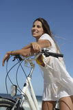 Woman with bike on the beach Stock Photos