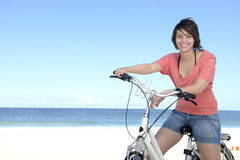 Woman with bike on the beach Royalty Free Stock Photography