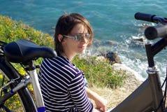 Woman with bike. Beautiful woman on bike outdoors Royalty Free Stock Photo