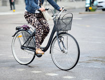 Woman on bike Royalty Free Stock Images