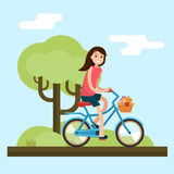 Woman on bike Stock Photo