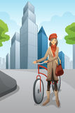 Woman with a bike in the city Royalty Free Stock Photography