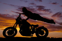 Woman bike flying Royalty Free Stock Images