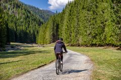 Woman on bike in forest. Girl on mountain bike in forest at Ludrovska valley in Slovakia royalty free stock photo