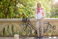 Woman with bike Stock Images