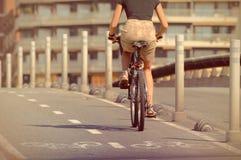 Woman on bike goint to work Stock Photos