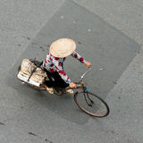 Woman on a bike, Hanoi, Vietnam Royalty Free Stock Photo