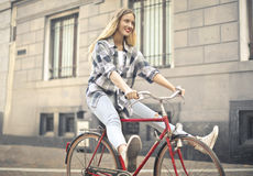 Woman with bike Royalty Free Stock Photography