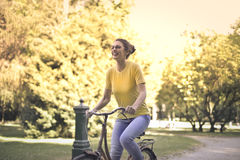 Woman with bike Royalty Free Stock Photos