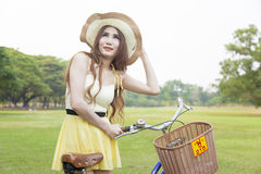 Woman with bike on the lawn Stock Photos