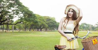 Woman with bike on the lawn Royalty Free Stock Photography