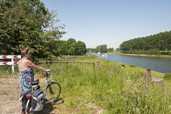 Woman with bike looking at the river Royalty Free Stock Photography
