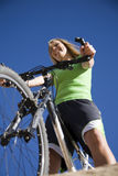 Woman on bike low view Royalty Free Stock Photography