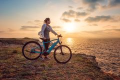 Woman with a bike in the nature stock images