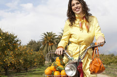 Woman on Bike with Oranges Stock Photo