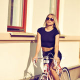 Woman on a bike Stock Photography