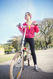 Woman with bike outdoors. Happy young woman riding a bike Royalty Free Stock Photos