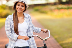 Woman bike outdoors Stock Photography