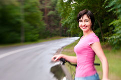 Woman with bike on the rainy forest Royalty Free Stock Image