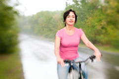 Woman with bike on the rainy forest Stock Photos