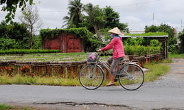 A woman with bike on rural road in Sadek, southern Vietnam Royalty Free Stock Photos