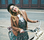 Woman with bike at street Stock Photos
