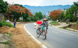 A woman with the bike on street in Hanoi, Vietnam Royalty Free Stock Photo