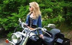 Woman and bike Stock Photography