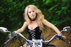 Woman and bike Stock Photos