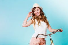 Woman with bike. Summer fashion and recreation. Royalty Free Stock Photo