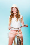 Woman with bike. Summer fashion and recreation. Royalty Free Stock Images