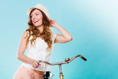 Woman with bike. Summer fashion and recreation. Stock Image