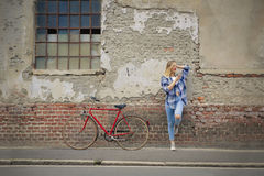 Woman with bike Stock Image