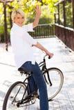 Woman bike waving Stock Photo