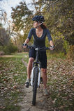Woman on bike Stock Photography