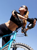 Woman Biker 240. Woman on mountain bike with water bottle looking up Stock Image