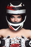 Woman in biker helmet Stock Images