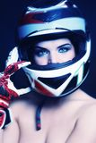 Woman in biker helmet Stock Photography