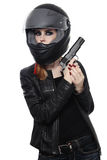 Woman in biker helmet with gun Stock Photo