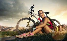 Woman biker Stock Images